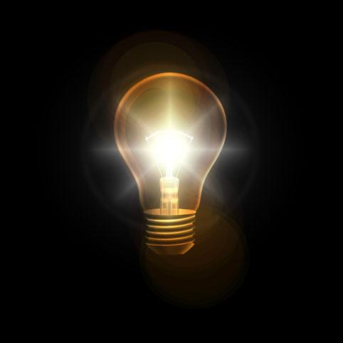 Pimeässä loistava hehkulamppu hyvän idean merkiksi.